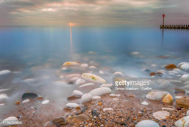 scenic view of sea against sky during sunset - bridlington stock pictures, royalty-free photos & images
