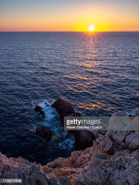 scenic view of sea against sky during sunset - marek stefunko stock photos and pictures