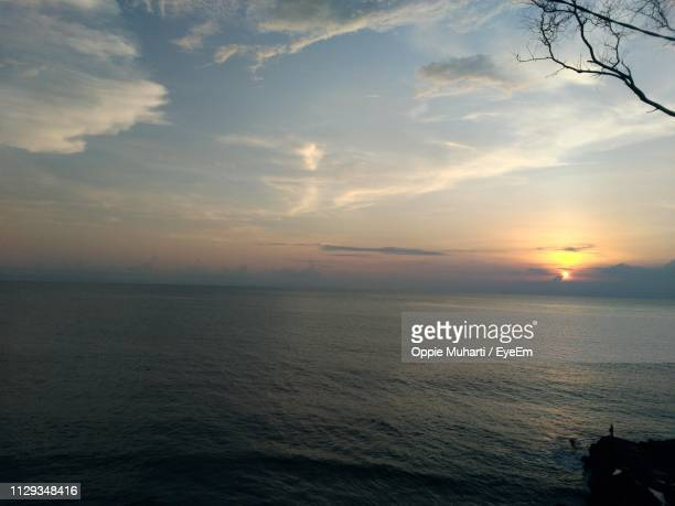 scenic view of sea against sky during sunset - oppie muharti stock pictures, royalty-free photos & images