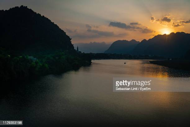 scenic view of sea against sky during sunset - phong nha kẻ bàng national park stock photos and pictures