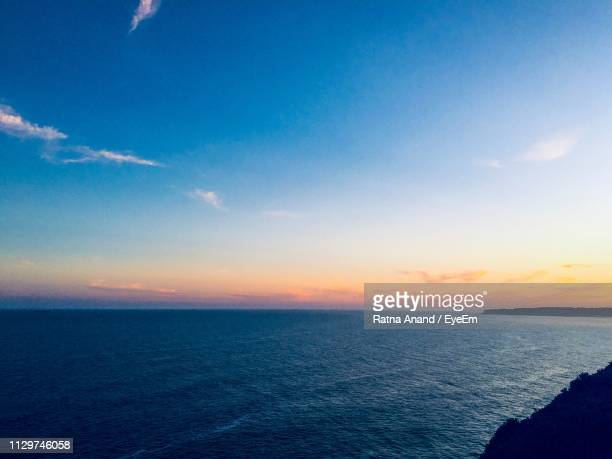 scenic view of sea against sky during sunset - newcastle new south wales stock pictures, royalty-free photos & images