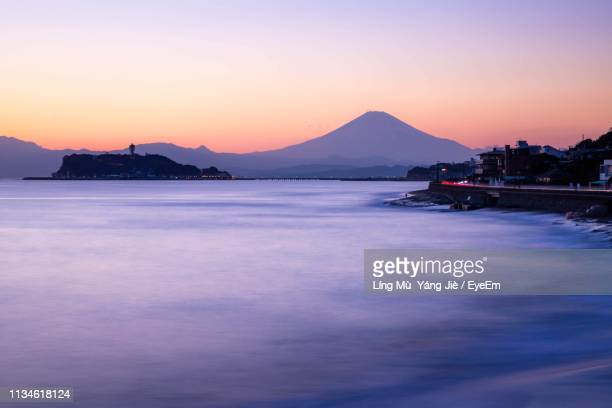 scenic view of sea against sky during sunset - kanagawa prefecture stock pictures, royalty-free photos & images