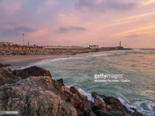 scenic view of sea against sky during sunset - rabat morocco stock pictures, royalty-free photos & images