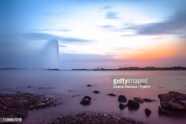scenic view of sea against sky during sunset - fountain stock pictures, royalty-free photos & images