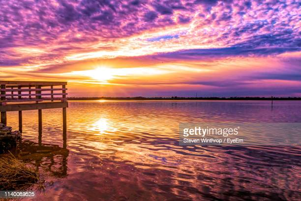 scenic view of sea against sky during sunset - wilmington north carolina stock photos and pictures