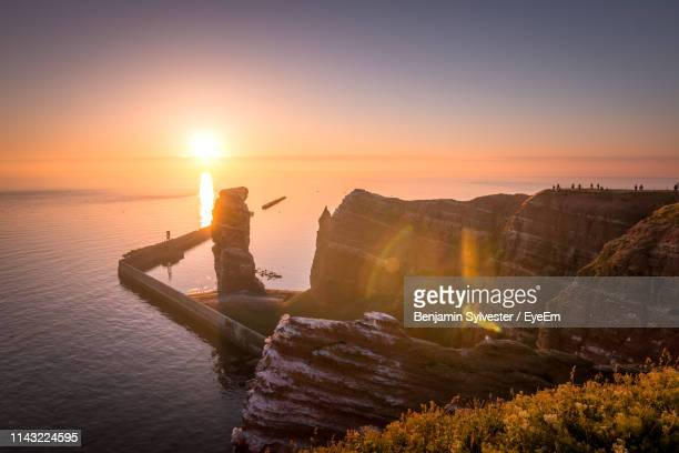 scenic view of sea against sky during sunset - helgoland stock pictures, royalty-free photos & images
