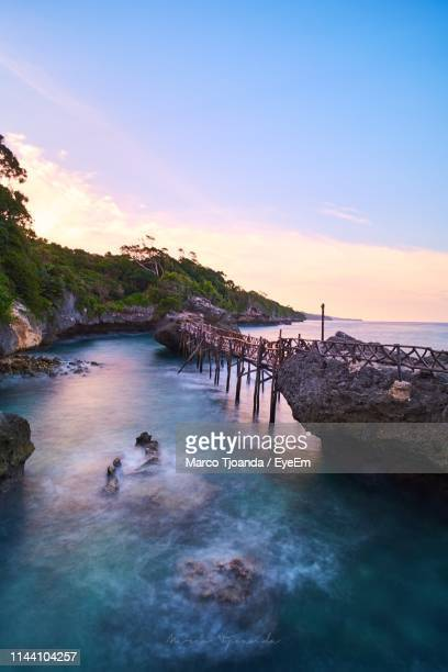 scenic view of sea against sky during sunset - makassar stock pictures, royalty-free photos & images