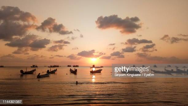 scenic view of sea against sky during sunset - fishing boat stock pictures, royalty-free photos & images