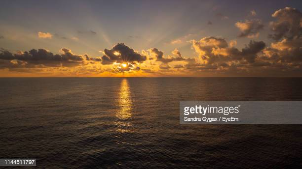 scenic view of sea against sky during sunset - sandra gygax stock-fotos und bilder