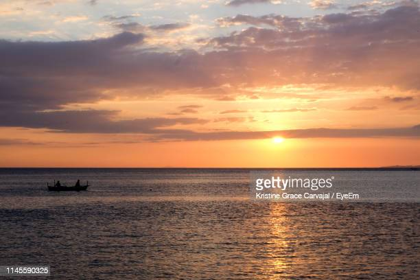 scenic view of sea against sky during sunset - carvajal ストックフォトと画像