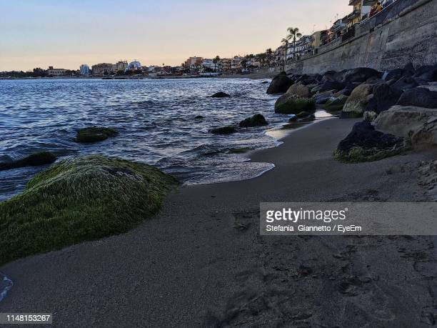 scenic view of sea against sky during sunset - giardini naxos stock pictures, royalty-free photos & images