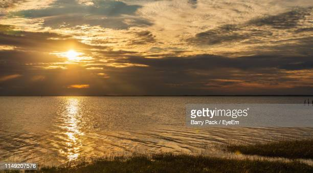 scenic view of sea against sky during sunset - tallahassee stock pictures, royalty-free photos & images