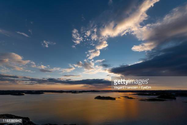 scenic view of sea against sky during sunset - vegard hanssen stock pictures, royalty-free photos & images