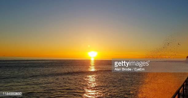 scenic view of sea against sky during sunset - saltdean stock pictures, royalty-free photos & images