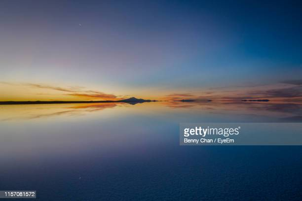 scenic view of sea against sky during sunset - salt flat stock pictures, royalty-free photos & images