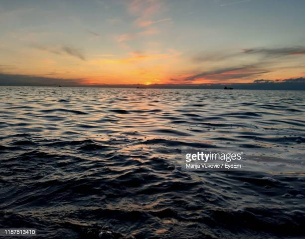 scenic view of sea against sky during sunset - koper stock photos and pictures