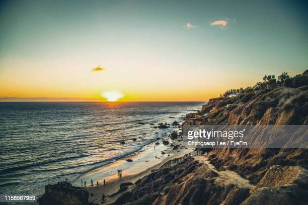 scenic view of sea against sky during sunset - malibu beach stock pictures, royalty-free photos & images