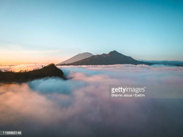 scenic view of sea against sky during sunset - kintamani district stock pictures, royalty-free photos & images