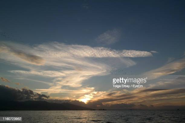 scenic view of sea against sky during sunset - tolga erbay stock photos and pictures