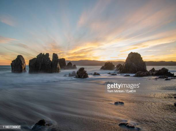 scenic view of sea against sky during sunset - wellington new zealand stock pictures, royalty-free photos & images