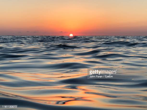 scenic view of sea against sky during sunset - west palm beach stock pictures, royalty-free photos & images
