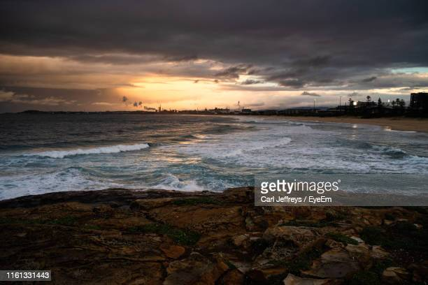 scenic view of sea against sky during sunset - wollongong stock pictures, royalty-free photos & images