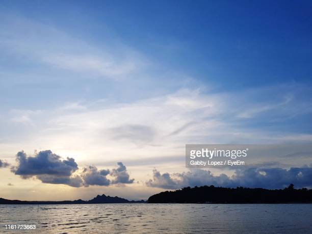 scenic view of sea against sky during sunset - gabby lopez stock pictures, royalty-free photos & images