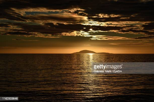 scenic view of sea against sky during sunset - gabriela stock pictures, royalty-free photos & images