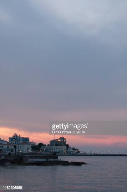 scenic view of sea against sky during sunset - spetses stock pictures, royalty-free photos & images