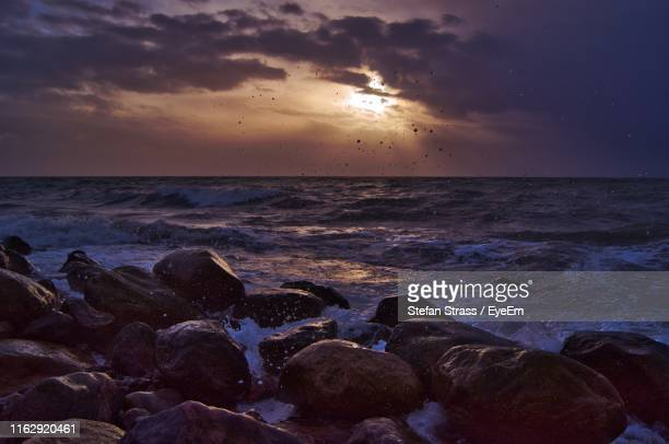 scenic view of sea against sky during sunset - fehmarn stock-fotos und bilder