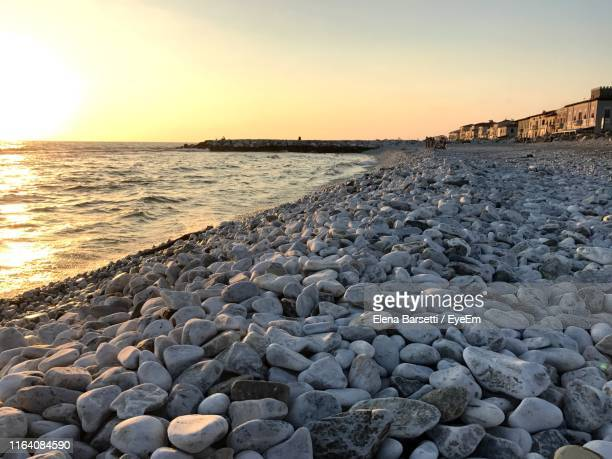 scenic view of sea against sky during sunset - 防波堤 ストックフォトと画像