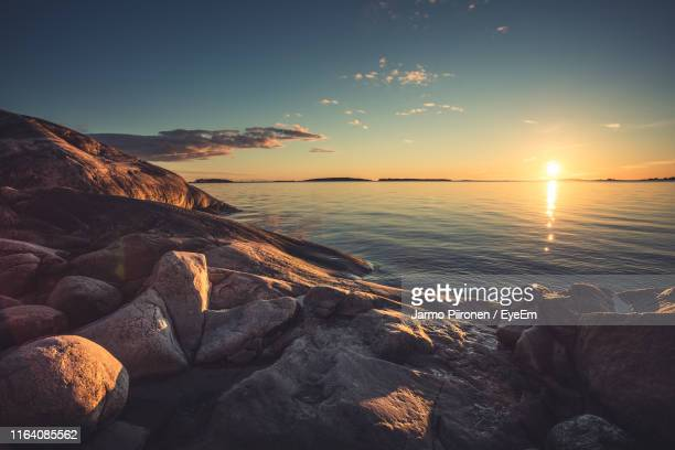 scenic view of sea against sky during sunset - archipelago stock pictures, royalty-free photos & images