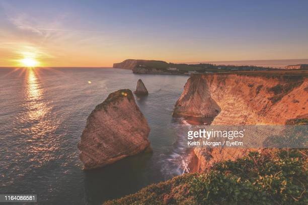 scenic view of sea against sky during sunset - isle of wight stock pictures, royalty-free photos & images