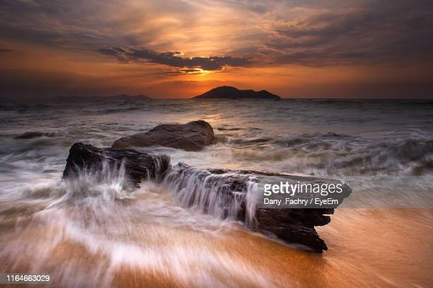scenic view of sea against sky during sunset - kalimantan stock pictures, royalty-free photos & images
