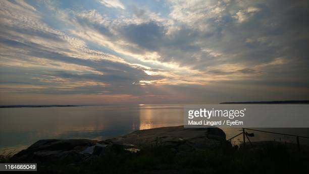 scenic view of sea against sky during sunset - lingard stock pictures, royalty-free photos & images