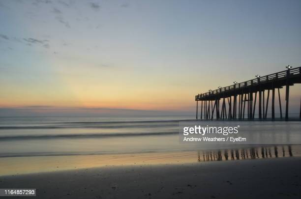 scenic view of sea against sky during sunset - kitty hawk beach stock pictures, royalty-free photos & images