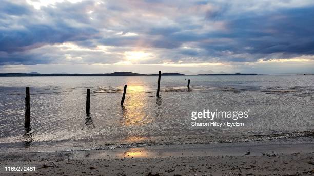 scenic view of sea against sky during sunset - tide stock pictures, royalty-free photos & images