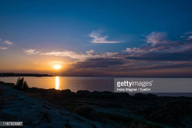 scenic view of sea against sky during sunset - denia stock pictures, royalty-free photos & images