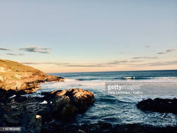 scenic view of sea against sky during sunset - coffs harbour stock pictures, royalty-free photos & images