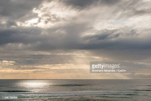 scenic view of sea against sky during sunset - biscarrosse photos et images de collection