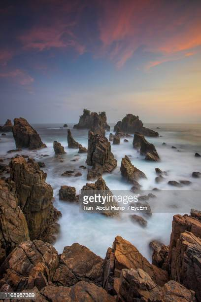 scenic view of sea against sky during sunset - tian abdul hanip stock photos and pictures