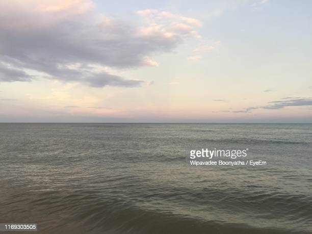 scenic view of sea against sky during sunset - wipavadee stock photos and pictures