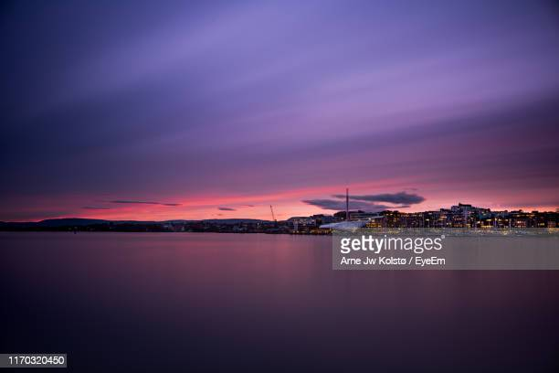 scenic view of sea against sky during sunset - arne jw kolstø stock pictures, royalty-free photos & images