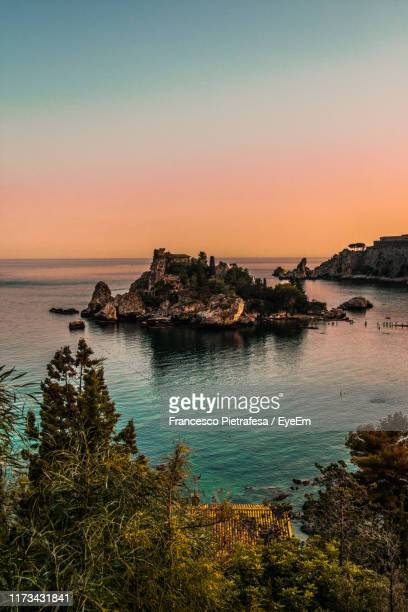 scenic view of sea against sky during sunset - taormina stock pictures, royalty-free photos & images