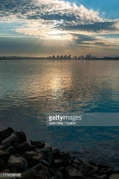 scenic view of sea against sky during sunset - josh utley stock pictures, royalty-free photos & images