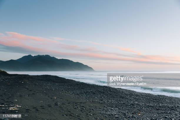 scenic view of sea against sky during sunset - marlborough new zealand stock pictures, royalty-free photos & images