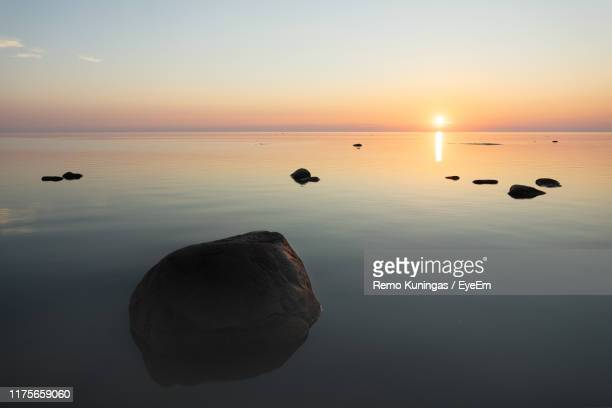scenic view of sea against sky during sunset - bedtime stock pictures, royalty-free photos & images