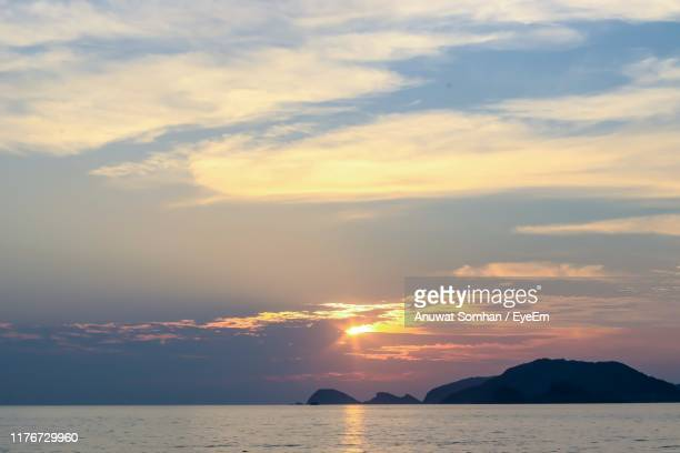 scenic view of sea against sky during sunset - anuwat somhan stock photos and pictures
