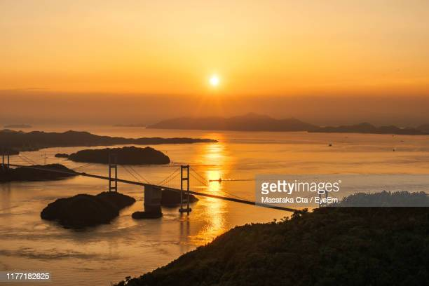 scenic view of sea against sky during sunset - 八月 ストックフォトと画像