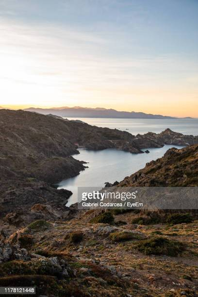 scenic view of sea against sky during sunset - roses catalonia stock pictures, royalty-free photos & images